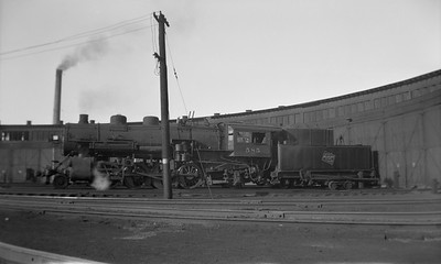 2021.001.NO.02.005N--ralph wehlitz 116 neg [Truesdell]--CMStP&P--steam locomotive 2-8-2 L2a 585 at roundhouse--St Paul MN--1949 1106
