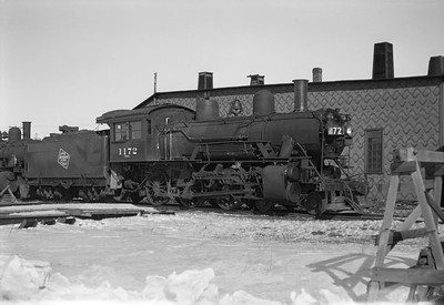2021.001.NO.02.012--ralph wehlitz 6x9 neg [photographer unknown]--CMStP&P--steam locomotive 4-6-0 G6ms 1172 at roundhouse--Tomahawk WI--no date