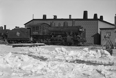 2021.001.NO.02.011--ralph wehlitz 6x9 neg [photographer unknown]--CMStP&P--steam locomotive 4-6-0 G6ms 1172 at roundhouse--Tomahawk WI--no date