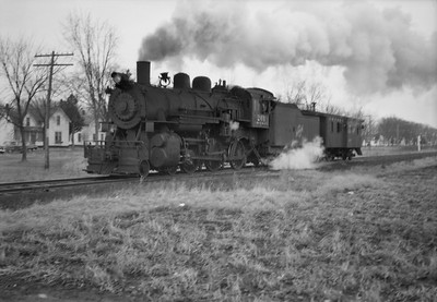 2021.001.NO.04.005--ralph wehlitz 6x9 neg [photographer unknown]--CStPM&O--steam locomotive 4-6-0 K-1 261 with caboose hop action--Humbird WI--no date