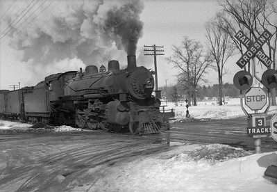 2021.001.NO.04.014--ralph wehlitz 6x9 neg [photographer unknown]--CStPM&O--steam locomotive 4-6-2 E-A 508 with freight train action scene--Merrillan WI--no date