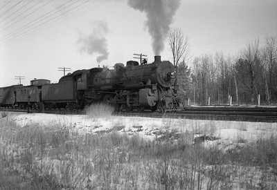 2021.001.NO.04.011--ralph wehlitz 6x9 neg [photographer unknown]--CStPM&O--steam locomotive 2-8-2 J-A 408 with caboose and freight cars--Merrillan WI--no date
