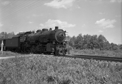 2021.001.NO.04.013--ralph wehlitz 6x9 neg [photographer unknown]--CStPM&O--steam locomotive 2-8-2 J-A 418 with caboose and freight cars--Merrillan WI--no date