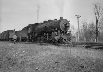 2021.001.NO.04.006--ralph wehlitz 6x9 neg [photographer unknown]--CStPM&O--steam locomotive 2-8-2 J-A 399 with caboose and freight cars--Merrillan WI--no date
