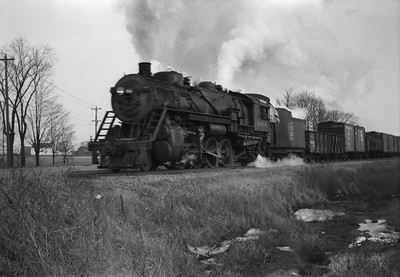 2021.001.NO.01.008--ralph wehlitz 6x9 neg [photographer unknown]--SOO--steam locomotive 2-8-2 L-1 1008 on freight train action on Nekoosa line--near Nekoosa WI--no date