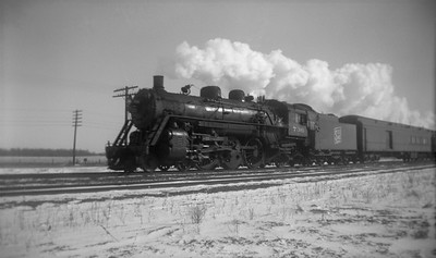 2021.001.NO.01.006--ralph wehlitz 116 neg [photographer unknown]--SOO--steam locomotive 4-6-2 H-3 736 on passenger train action--Spencer WI--no date