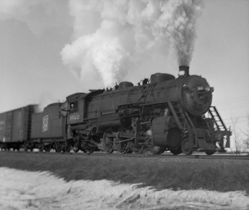 2021.001.NO.01.010--ralph wehlitz 127 neg [photographer unknown]--SOO--steam locomotive 2-8-2 L-2 1022 on freight train action--near Marshfield WI--no date