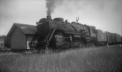 2021.001.NO.01.009--ralph wehlitz 116 neg [photographer unknown]--SOO--steam locomotive 2-8-2 L-1 1009 on freight train action--location unknown--no date