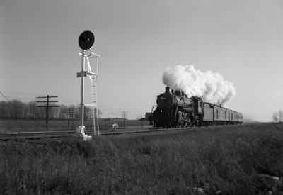 2021.001.NO.01.016--ralph wehlitz 6x9 neg [photographer unknown]--SOO--steam locomotive 4-6-2 H-21 2710 on passenger train action--near Marshfield WI--no date