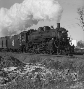 2021.001.NO.01.018--ralph wehlitz 120 neg [photographer unknown]--SOO--steam locomotive 4-6-2 H-23 2719 on passenger train action--Marshfield WI--no date