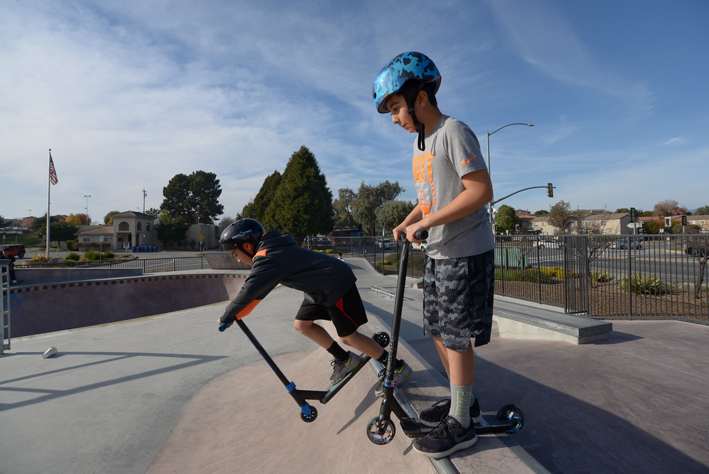 . Oscar Gutierrez, right, waits for his brother, Diego, to ride down the ramp at Ramsay Skate Park in Watsonville on Saturday afternoon. (Juan Reyes)