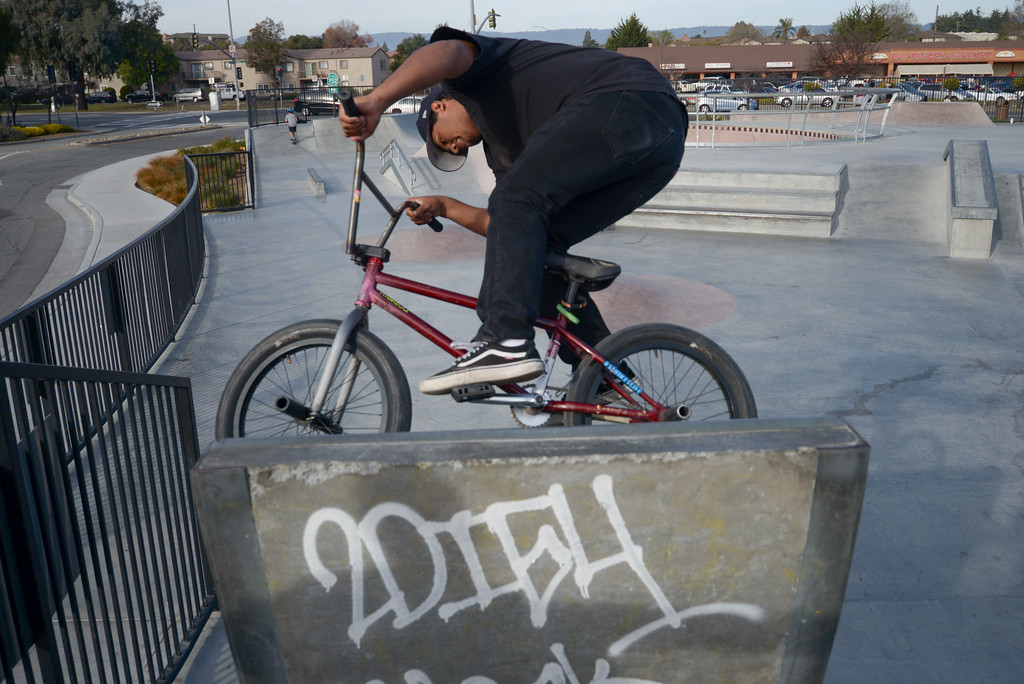 . Edwin Gonzalez of Watsonville rides his bike up a ramp at Ramsay Skate Park on Saturday afternoon. (Juan Reyes)