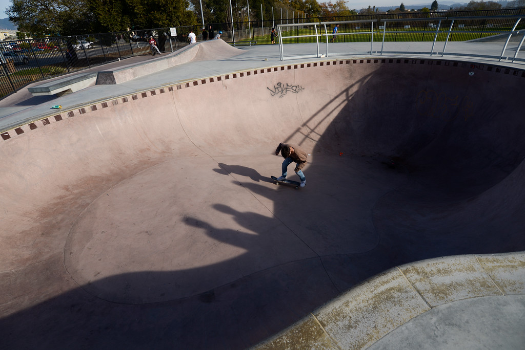 . A kid rides on his skatepark inside the swimming pool at Ramsay Skate Park in Watsonville on Saturday afternoon. (Juan Reyes)