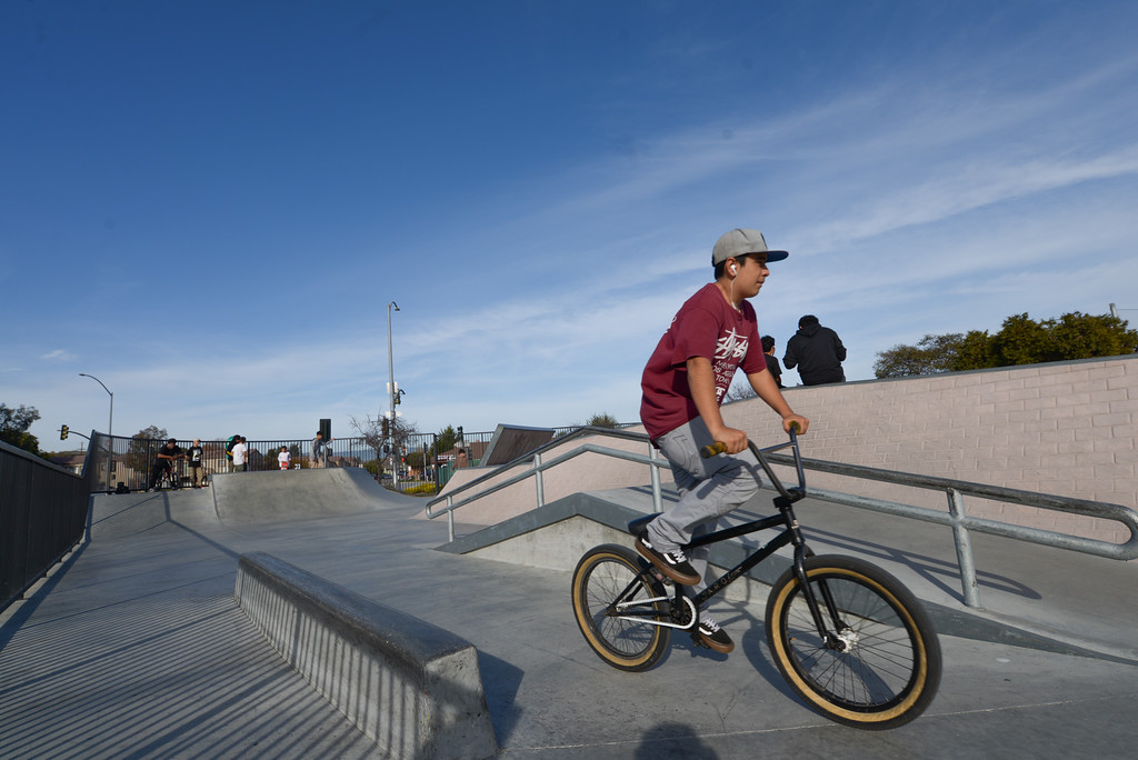 . A kid rids his bike through Ramsay Skate Park in Watsonville on a Saturday afternoon. (Juan Reyes)