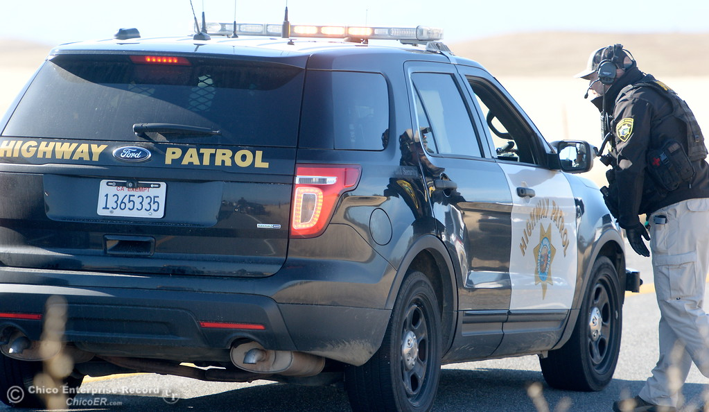 . A California Highway Patrol officer talks with another along Rancho Tehama Road Tues. Nov. 14, 2017.  (Bill Husa -- Enterprise-Record)