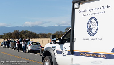A California Department of Justice vehicle arrives while Rancho Tehama Road is closed to traffic at Paskenta Road, where worried residents and reporters lined the road Tues. Nov. 14, 2017.  (Bill Husa -- Enterprise-Record)