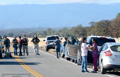 Rancho Tehama Road is closed to traffic at Paskenta Road, where worried residents and reporters lined the road Tues. Nov. 14, 2017.  (Bill Husa -- Enterprise-Record)