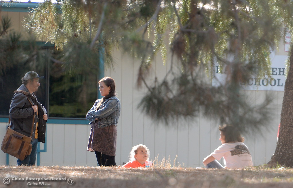 . People talk outside at Rancho Tehama Elementary School following several shootings in the Northern California community Tues. Nov. 14, 2017.  (Bill Husa -- Enterprise-Record)