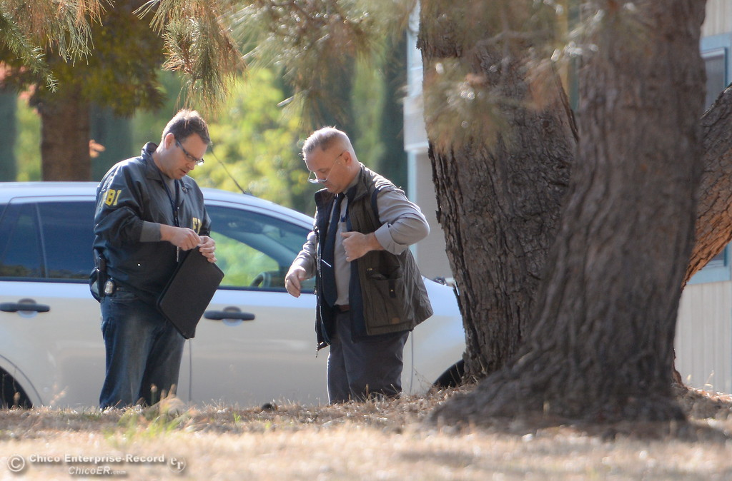 . AN FBI Officer talks with a man at Rancho Tehama Elementary School following several shootings in the Northern California community Tues. Nov. 14, 2017.  (Bill Husa -- Enterprise-Record)