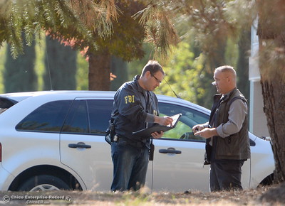 AN FBI Officer talks with a man at Rancho Tehama Elementary School following several shootings in the Northern California community Tues. Nov. 14, 2017.  (Bill Husa -- Enterprise-Record)