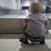 Waiting for his car seat to arrive at Melbourne airport