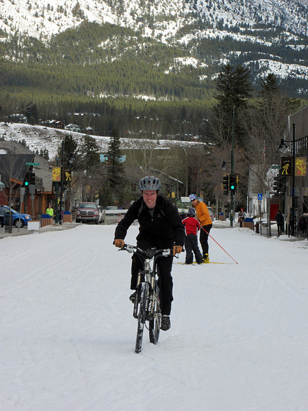 <b>14 Mar 2011</b> Brendan biking down Main Street in the snow