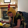 Megan with Darren's rooster-hat, with sleeping Finn on her back.