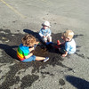 <b>6 August 2012</b> Playing in the parking lot puddle