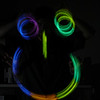 Playing with connectible glow sticks - making a smiley face