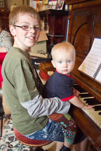 Finn playing the piano with Zac