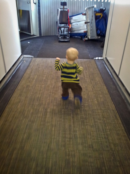 Running down the walkway and onto the plane