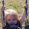 November 18 - Sweet, sweet Carly, she swings high for a small tyke.