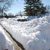 My car behind the snow piles.