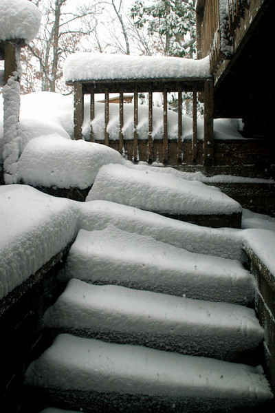 February 6, 7:30 am, and the snow is still falling. Here's what things look like so far...<br /> The stairs outside my apartment.