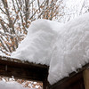 Snow on the deck's railing.