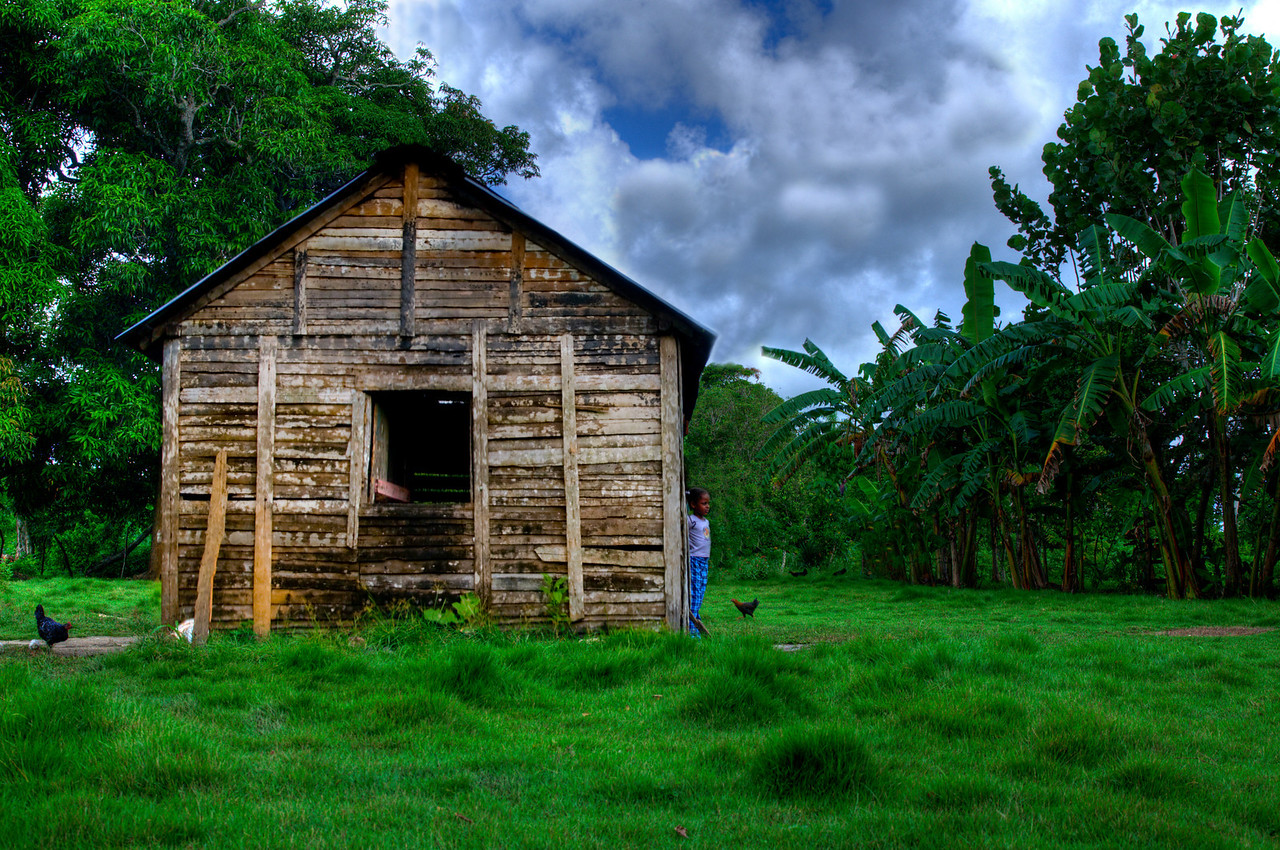 Day #1 - Dominican Girl<br /> <br /> Small farm house in the Dominican Republic.  I took this photo while on vacation.  This is an HDR treatment made with 3 bracketed exposures. I know the colors are quite punchy but this how I remember this scene.  Very beautiful place and beautiful people.