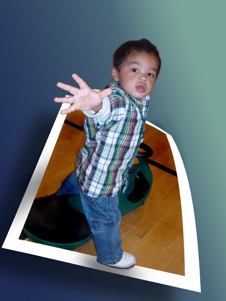 Day #27 - Photoshop Fun<br /> <br /> This is my nephew Devin.  I was bored so I decided to goof around a bit with Photoshop and created this Out Of Border picture using a few layer masks, gradients and shading.