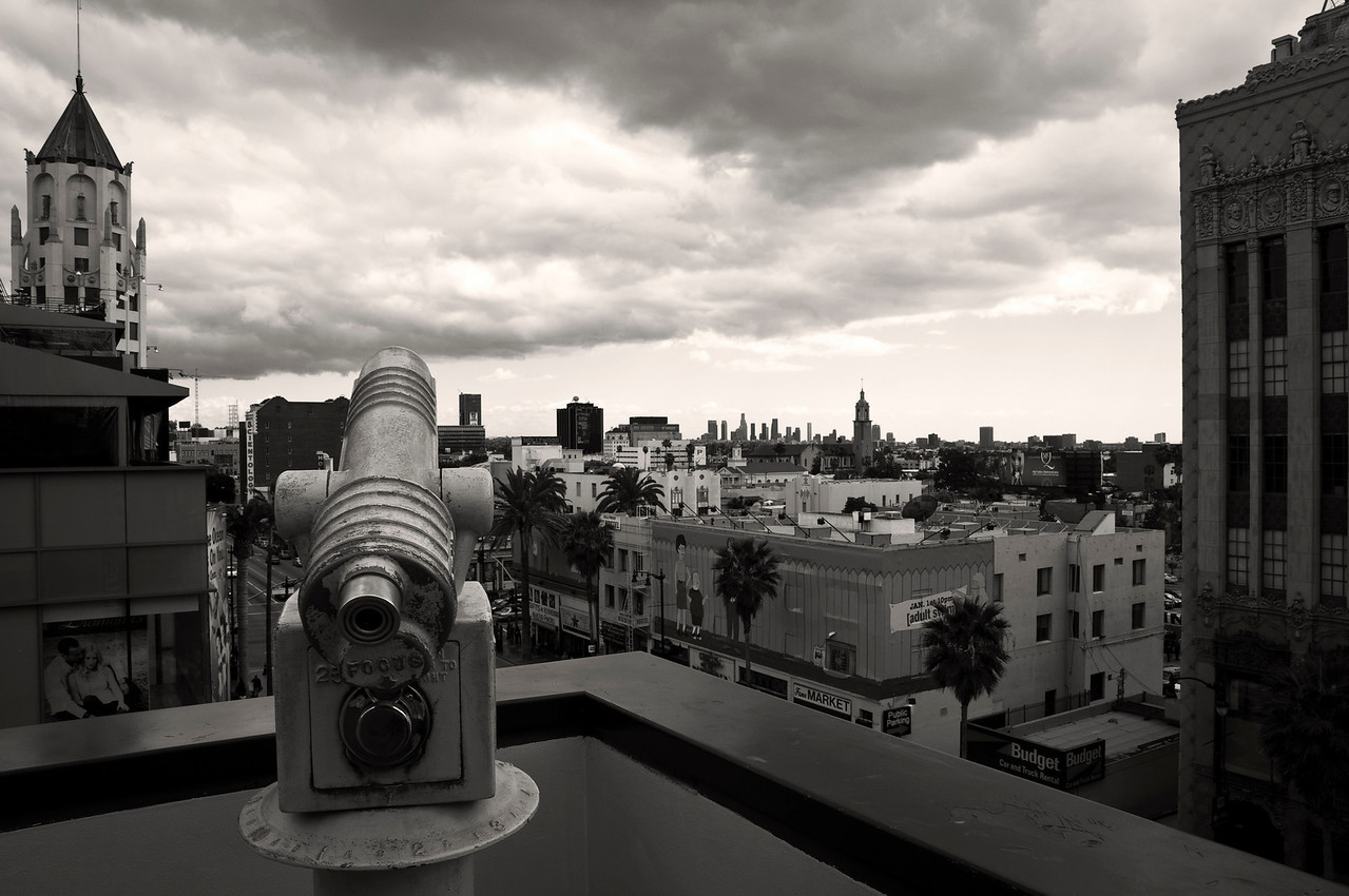 Day #44 - I can see my house from here! <br /> <br /> Telescope high above Hollywood Blvd.  We just had some rain storms so we had some nice clouds in the sky.  That's downtown Los Angeles way off in the horizon.