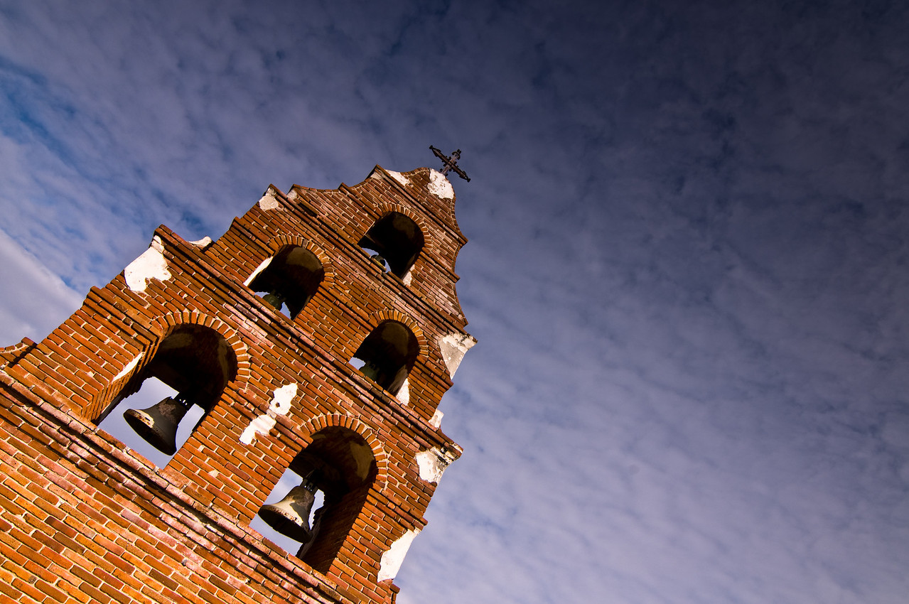 Day #33 - Bell Tower, Mission San Miguel Arcangel<br /> <br /> This is the bell tower the stands in front of walls of the old historic mission in San Miguel, CA.  This is one of 7 California Missions my wife and I have visited.  There are 21 in all and we  plan on seeing every one of them.<br /> <br /> Unfortunately, this mission was closed to the public because it suffered quite a bit of damage during an earthquake in 2003.  We did read that they have started renovating it and hope to reopen it once again in the near future.  We were disappointed because it looked quite amazing from the outside.