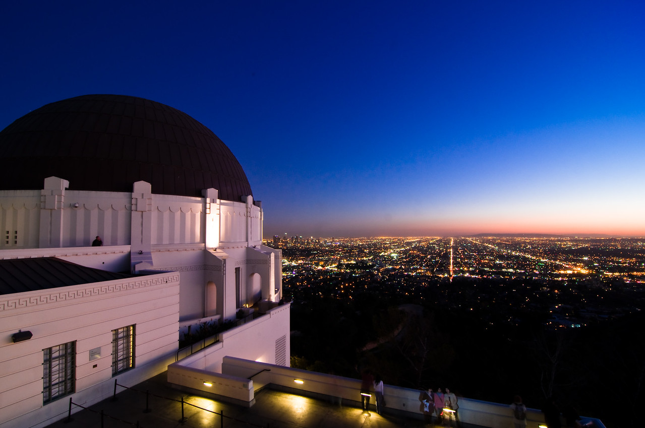Day #24 - Sunset at Griffith Observatory<br /> <br /> This is the view from Griffith Observatory within minutes of Sunset.  I tried to capture the beautiful view of Los Angeles but also the clean lines of the building. What caught my eye were the streets converging on the horizon and pinkish glow on the horizon.