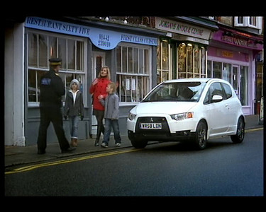 "This Mitsubishi commercial was shown every saturday during 2010 and was linked to the program ""You've been framed"", which it sponsored. I am the Traffic warden"