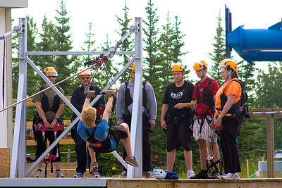 Darcie decided to do the zipline attraction at Canada Olympic Park.  This is her group getting instructions from the zipline expert on the baby test run.