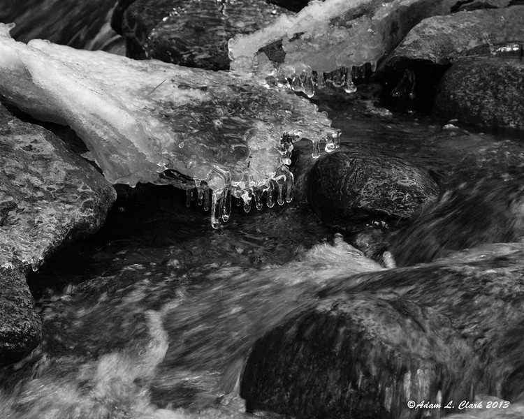 12.20.2013<br /> <br /> A small brook flows under ice created on the rocks