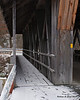 12.18.2013<br /> <br /> The slightly snow covered walkway onto an old covered bridge