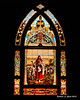 01.23.2013<br /> <br /> The stained glass window of a local chuch illuminated by the lights inside