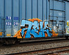 10.27.2014 <br><br>Colorful graffiti on a train car passing by