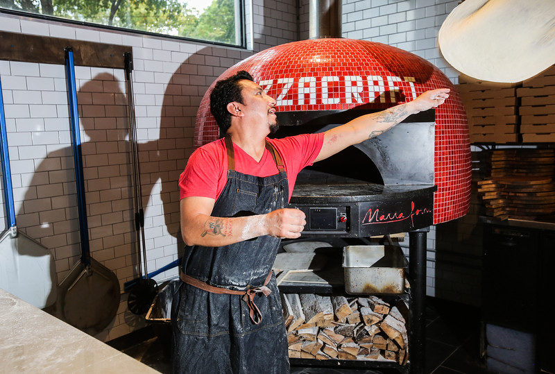 Photo by CandaceWest.com,<br /> March 4, 2016<br /> Executive Chef Danny Hernandez hand tossing pizza dough.<br /> Apothecary 330,<br /> 330 SW 2nd St.<br /> Fort Lauderdale, Florida 33312<br /> (954) 616-8028,<br /> JEY Hospitality Group is launching its new<br />  2-for-1 block-wide Happy Hour available at its five restaurant locations on Fort Lauderdale's Himmarshee Street. Kicking off on Thursday, March 3rd, the new 2-for-1 specials will make Downtown Fort Lauderdale the ultimate Happy Hour destination. Guests will receive a one-and-a-half inch wooden chip upon purchase of their first drink and can use the chip to redeem their second drink at Himmarshee Public House, ROK:BRGR, TacoCraft, Pizza Craft or Apothecary 330.