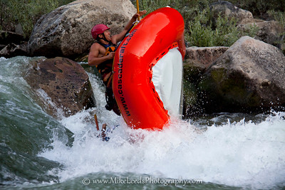 Team Cascade with an intentional raft flip during one of the events for the Guide Olympics. South Fork Payette River, Idaho.   Banks Mag.