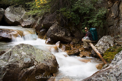 Brian Ward taking a break next to Redfish Lake Creek in the Sawtooth Mountains, Idaho.
