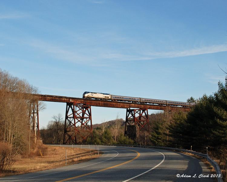 04.08.2013<br /> Amtrak's northbound Vermonter crosses a steel bridge in Claremont, NH